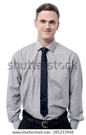 Confident male executive with hands in his pockets