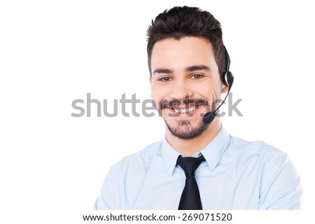 Confident male operator. Portrait of handsome young male operator in headset looking at camera and smiling while standing against white background - stock photo
