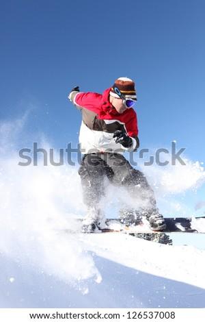 Confident male snowboarder - stock photo