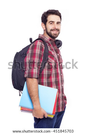 Confident male student standing with backpack and notebooks on white background