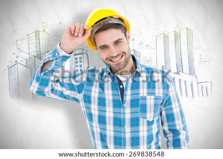 Confident male technicial wearing hard hat against crumpled white page - stock photo