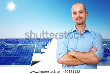 confident man and power solar station - stock photo