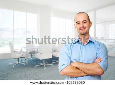 confident man crossed arms in office - stock photo
