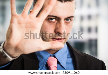 Confident man making stop sign - stock photo