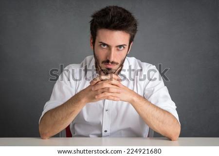 Confident man portrait over dark grunge background. - stock photo