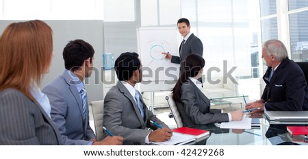 Confident manager discussing a new strategy his team in the office - stock photo