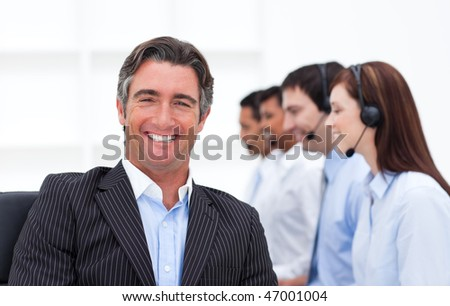 Confident manager presenting a call center in company - stock photo