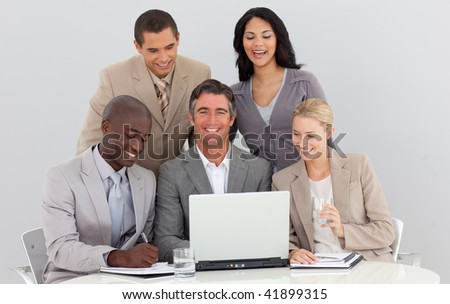 Confident manager working with his team in the office