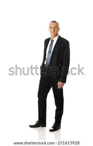 Confident mature businessman with hand in pocket. - stock photo