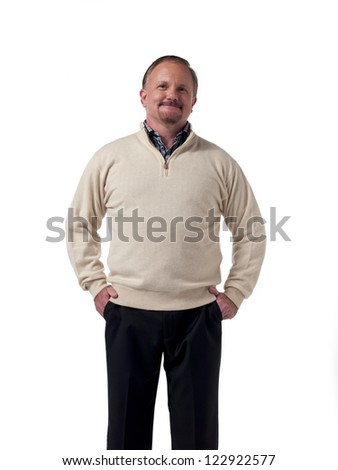 Confident mature businessman with hands in pockets standing over white background