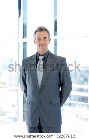 Confident mature leadership standing in office - stock photo