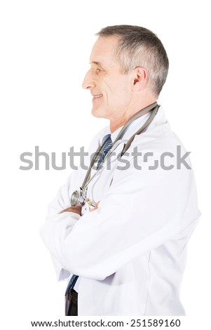 Confident mature male doctor with folded arms.