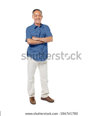 Confident Mature Man Standing with Arms Crossed - stock photo