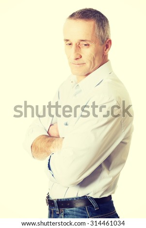 Confident mature man with folded arms.
