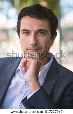 Confident middle age businessman close up portrait outdoors in Rome, Italy.