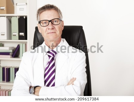 Confident Middle Age Medical Doctor, Looking at Camera - stock photo