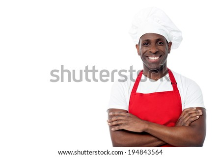 Confident middle aged chef with arms crossed - stock photo