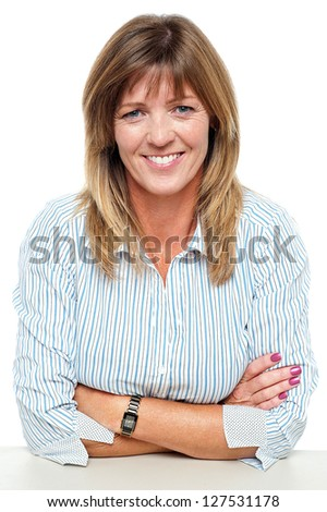 Confident middle aged entrepreneur posing with her arms crossed. - stock photo