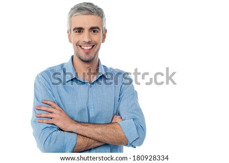 Confident middle aged man with crossed arms - stock photo