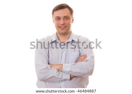 Confident middle aged man with hands folded standing on white background