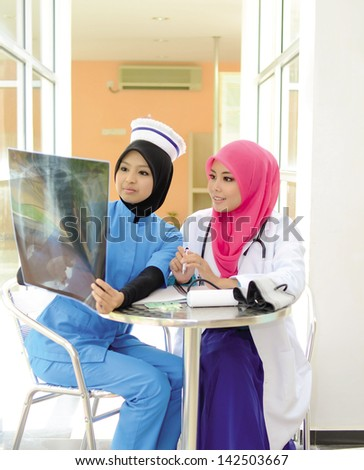 Confident Muslim doctor busy conversation at hospital