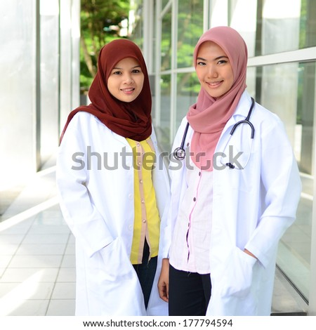 Confident Muslim medical student pose and smile at hospital - stock photo