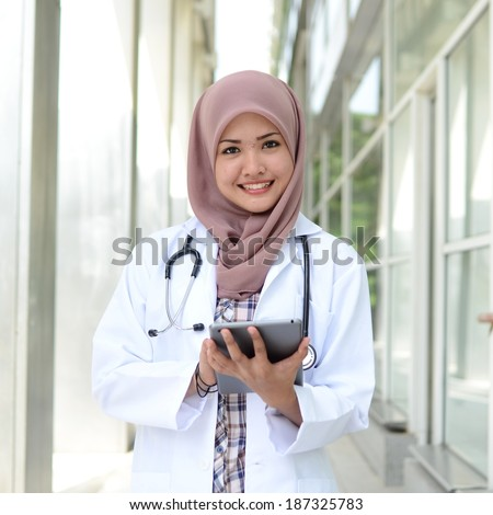 Confident Muslim medical student pose at hospital