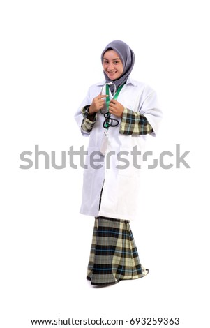 Confident muslimah doctor holding a stethoscope isolated in whit