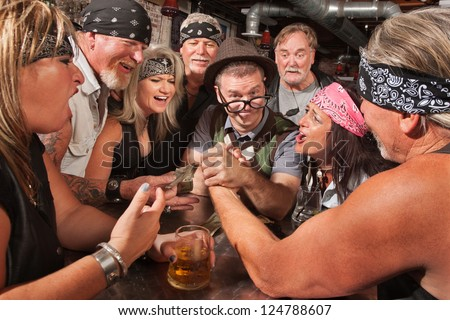 Confident nerd wins arm wrestling match in biker bar