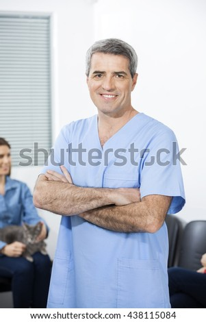 Confident Nurse With Arms Crossed Standing In Clinic - stock photo