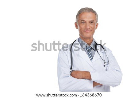 Confident old man looking at camera. Having crossed arms and isolated on white