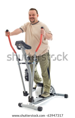 Confident overweight man exercising on elliptical trainer - isolated - stock photo