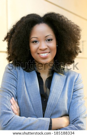 Confident Professional Business African American Executive Businesswoman Happy Arms Crossed and Smiling  - stock photo