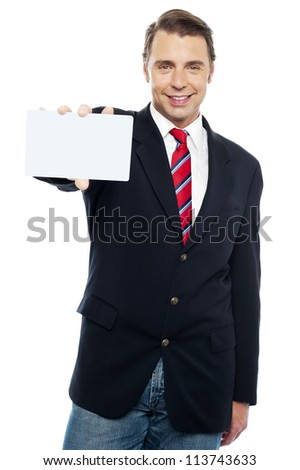 Confident sales representative presenting blank placard. Place your business ad here
