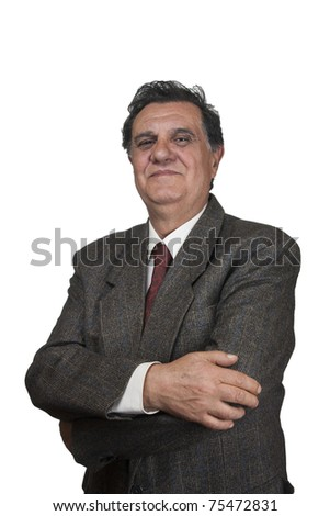 Confident senior businessman against white background - stock photo