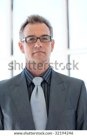 Confident senior businessman wearing glasses - stock photo