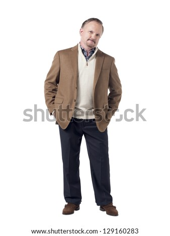 Confident senior businessman with hands on his pocket and standing on a white background