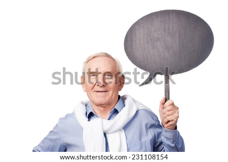 Confident senior man. Portrait of senior man smiling at camera and holding copy space while standing against white background  - stock photo