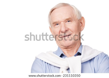 Confident senior man. Portrait of senior man smiling at camera while standing against white background  - stock photo