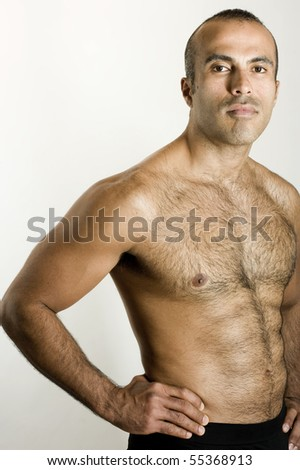 Confident Shirtless hispanic man