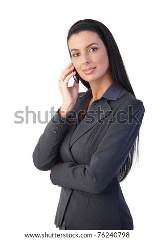 Confident smart businesswoman on mobile phone call, smiling at camera.? - stock photo