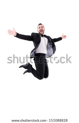 Confident Smart  Looking Man Laughing and Jumping Up, Enjoying His Success - Wearing black tuxedo, isolated on white background - Real laugh, real jump...  - stock photo