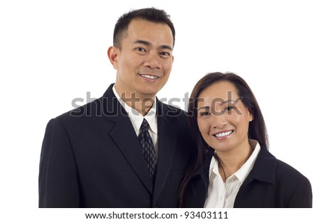 Confident smiling Asian couple isolated over white background - stock photo