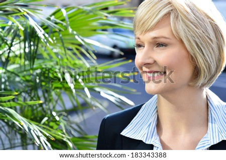 Confident smiling business woman looking away