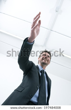 Confident smiling businessman giving an handshake bottom view. - stock photo