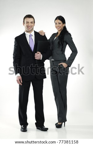 confident smiling male and female businesspeople