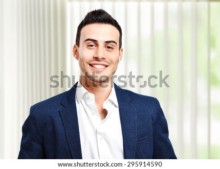 Confident smiling manager in his office - stock photo