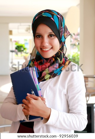 Confident Student holding a file - stock photo