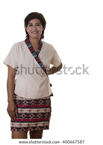Confident stylish woman wearing skirt with pattern and holding one hand behind her back