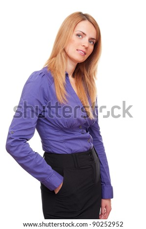 Confident successful business woman or student  standing and smiling in studio